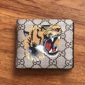 Gucci tiger print wallet